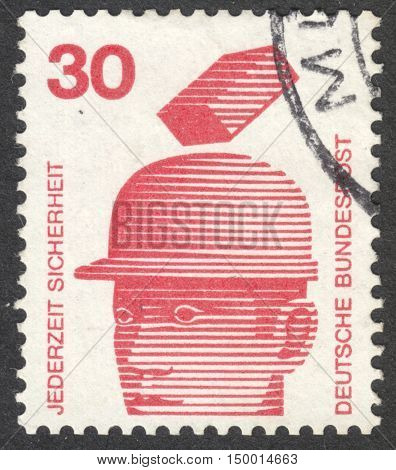 MOSCOW RUSSIA - CIRCA SEPTEMBER 2016: a stamp printed in GERMANY shows safety helmets prevent injury the series