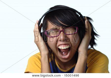 Asian teen girl screaming with headphones