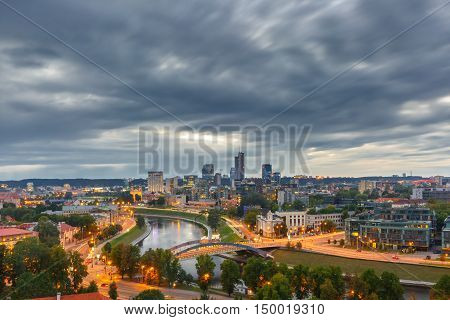 Aerial panoramic cityscape with skyscrapers of New Center of Vilnius from Gediminas Tower in the cloudy evening, Lithuania, Baltic states.
