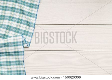 top view of napkin on white wooden table