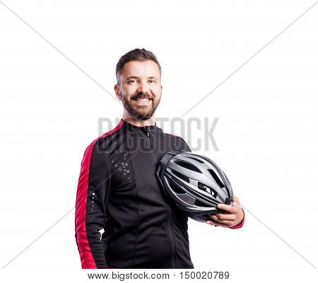 Hipster man in sports sweatshirt holding helmet in his hand, studio shot white background, isolated.
