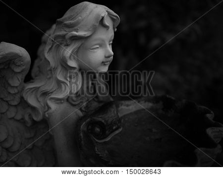 Gray angel plaster statue The garden is decorated in European style vintage statue Girl. Low key.