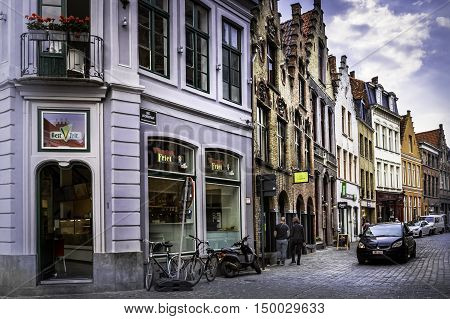 BRUGES, BELGIUM - MAY 12, 2016: Cobblestone bricks line the streets of scenic Bruges, Belgium. Bruges is a popular tourist destination because of it's historical significance and its proximity to Flanders Fields.