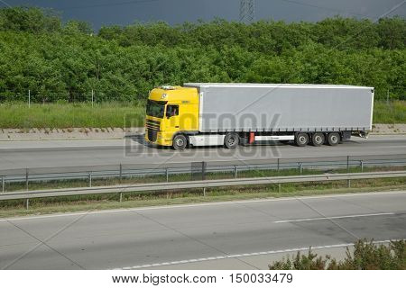 BUDAPEST, HUNGARY - MAY 3, 2016: Truck passing by on Highway M0. The M0 is an important transit ring around Budapest connecting all main motorways of the country.