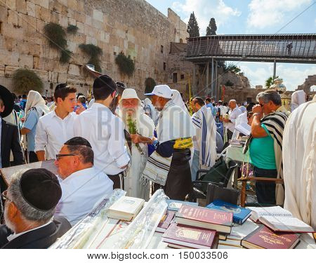 JERUSALEM, ISRAEL - OCTOBER 12, 2014: Blessing Cohen in Sukkot. Morning autumn Sukkot. Religious Jews have come to the Western wall of the Temple