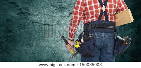 Builder with hammer and wooden planks.