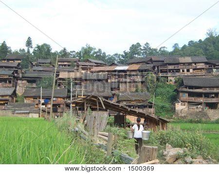 Dong Village With A Woman Bringing Back Some Water, Hunan, China