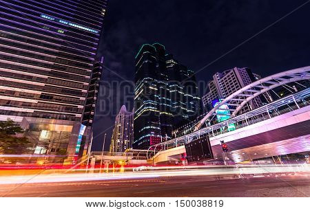 beautiful lighting city scape of skyline office building in heart business capital bangkok thailand this scene photography in important modern sky scraper landmark at dusky time slow shutter speed