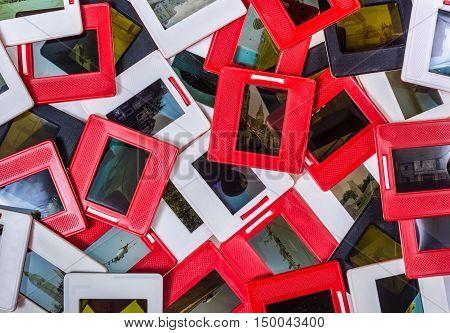 Photo frames for slide - art background. Bunch of memories - old slides 35mm diapositives pile.