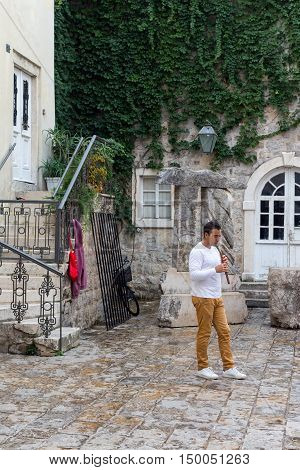 17.09.2016 A young man playing the flute in the old town of Budva Montenegro