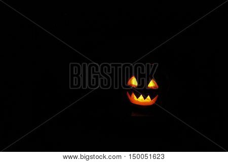 frightful ghost face glowing on Halloween in the darkness