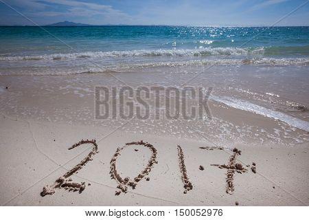 New year 2017 celebration on sea beach concept