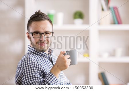 Male Drinking Coffee At Workplace