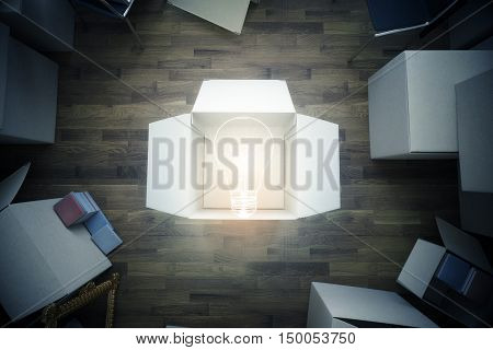 Top view of room with cardboard boxes and abstract light bulb. Idea concept. 3D Rendering