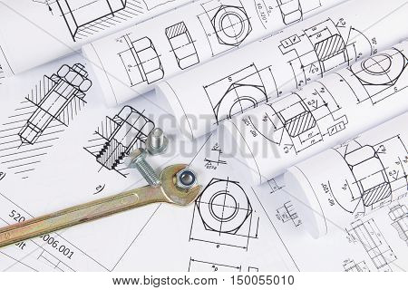 Mechanical Engineering Technology. Wrench, nuts and bolts on paper drawings