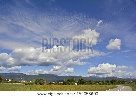 A mixture of different cloud types including cumulus and cirrus near the north east Italian village of Moimacco in late summer.