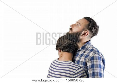 Portrait of a bearded guy who hugs a girl (wife girlfriend). The image symbolizes: care tenderness love allegiance protection ... There is a spase for your text.