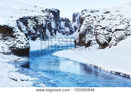 View of  Fjadrargljufur canyon and Fjadra river in winter, Iceland.