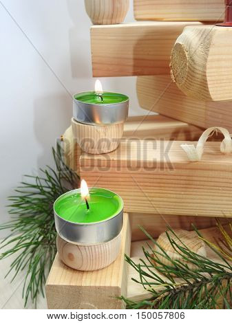 Small Candles On Boards.