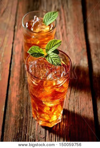 iced tea and mint on a wooden background