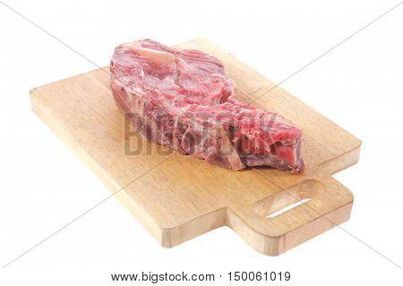 fresh raw red ribeye beef steak on bone over big cut wooden plate isolated on white background rib eye