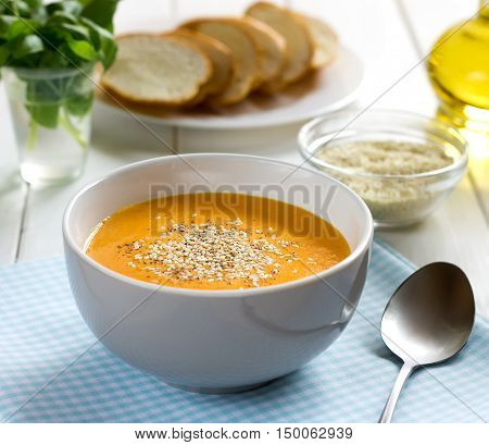 Pumpkin Soup-puree With Sesame In Bowl On A Blue Napkin.