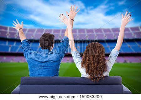 american football or soccer fans supporting their team or celebrating goal on stadium