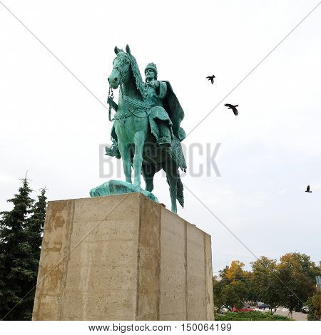 Orel Russia - October 01 2016: First in Russia Ivan the Terrible monument on concrete pedestal and crows in the sky square