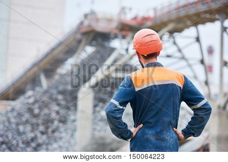 Worker looks at crushing and sorting automatic production line