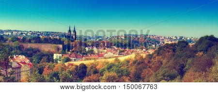 View to the Vysegrad in Prague, Czech Republic at autumn with cathedral and red roofs, travel seasonal background - panoramic image