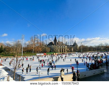 Ice skaters in City Park Ice Rink in Budapest, Hungary. Opened in 1870, it is the largest and one of the oldest ice rinks in Europe.