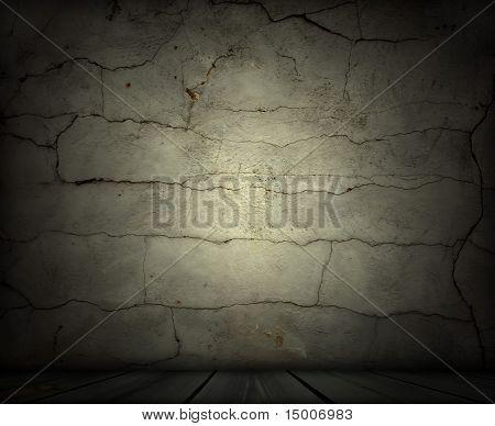 Cracked Wall in Dark Empty Room