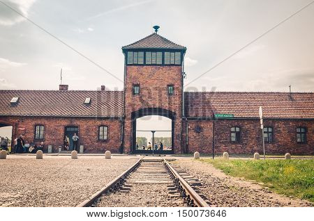 OSWIECIM POLAND - MAY 12 2016: Main gate in Auschwitz Birkenau in Brzezinka Poland.