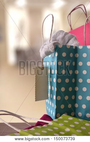 Shopping Bags With New Clothes Inside In A Shop Vertical