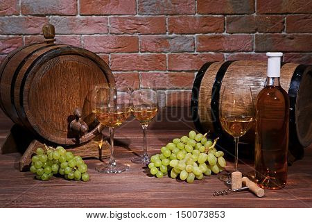 Composition of white wine on brick wall background