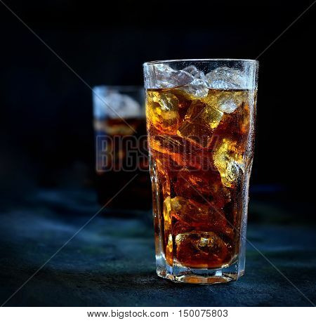 flavored ice tea in a glass on a dark background