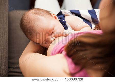 Woman Breastfeeding Her Newborn Baby