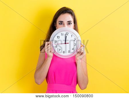 Woman With Clock Showing Nearly 12