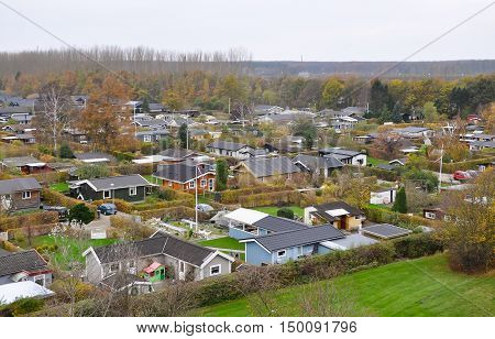 Typical scandinavian housing estate in Copenhagen, Denmark, an aerial view. Small beautiful colorful houses, top view