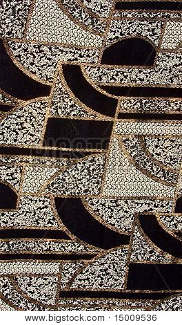 Black tissue pattern with gold. Black fabric pattern with gold
