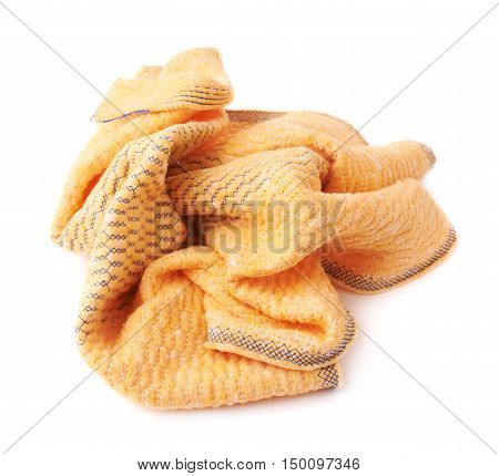 Crumpled yellow towel rag isolated over the white background