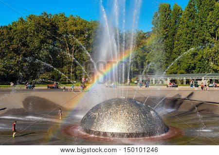 SEATTLE WA - SEPTEMBER 10 2016: The International Fountain in Seattle Center built for the 1962 World's Fair delights children and adults as the water syncs with music.