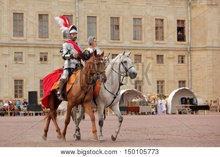 GATCHINA, ST. PETERSBURG, RUSSIA - SEPTEMBER 10, 2016: Actors in images of Emperor Nicholas I with his wife in front of Gatchina palace during the festival Gatchinskaya Byl