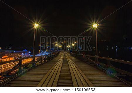 The old wooden bridge Bridge collapse Bridge across the river and Wood bridge (Mon bridge ) at sangkhlaburi in dark night kanchanaburi Province Asia thailand