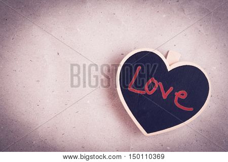 Wooden heart shape with wording