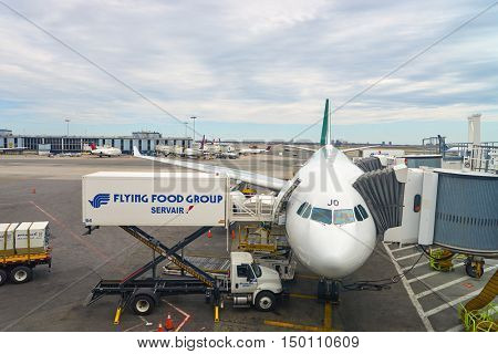 NEW YORK - APRIL 06, 2016: passenger jet airplane docked at JFK Airport. John F. Kennedy International Airport is a major international airport located in the borough of Queens in New York City.