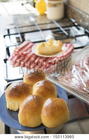 french bread rolls and cured ham at breakfast