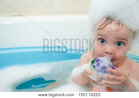 Little Girl Bathes In A Bath