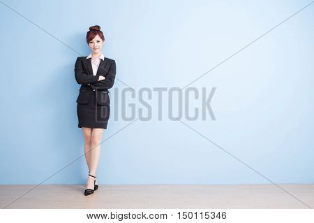 business woman is smile to you with blue background asian