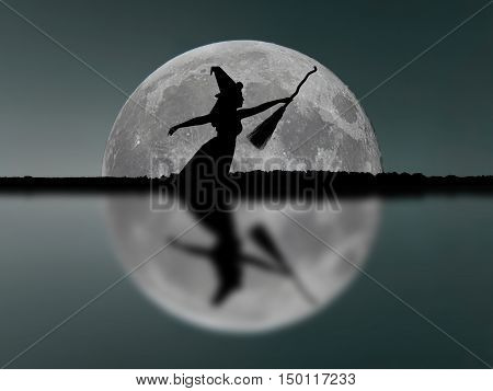 Halloween Witch Silhouette Flying With Broomstick. Full Moon. Reflection.